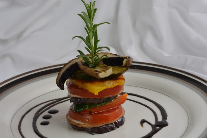 Vegetable Stacks with a balsamic glaze swirl.