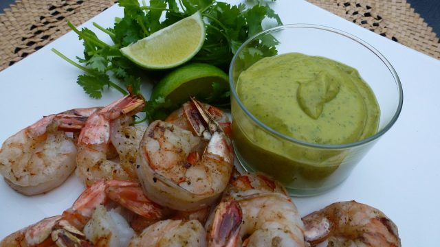 A dish of Avocado Chipotle Sauce with grilled shrimp.