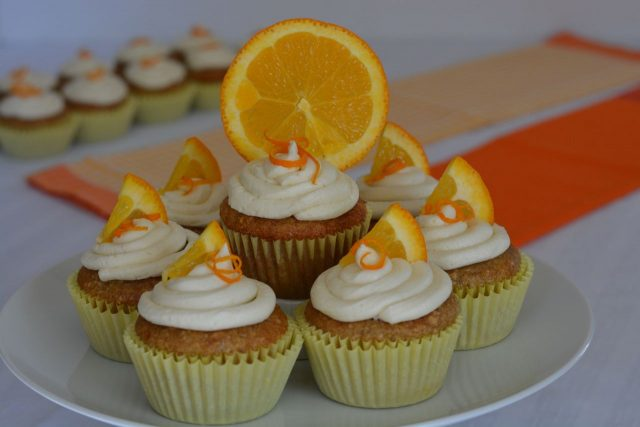 A pedestal tray filled with gluten free Orange Cupcakes.