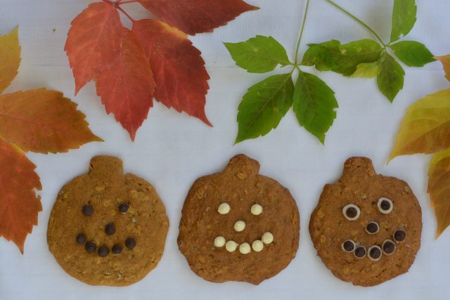 Pumpkin Chocolate Chip Cookies in the shape of Jack-o-lanterns.