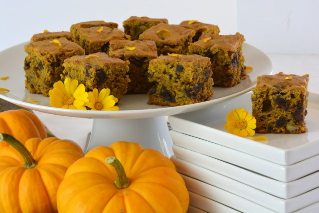 Pumpkin Date Cake on a pedestal tray garnished with calendula petals.