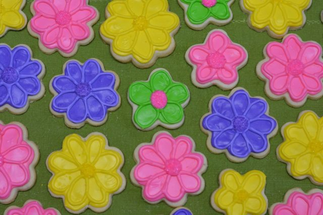 Brightly coloured royal icing on Gluten Free Sugar Cookies