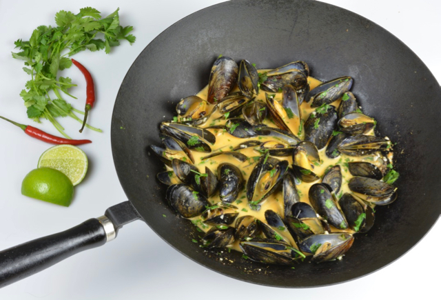 Thai Coconut Mussels with red curry paste and cilantro