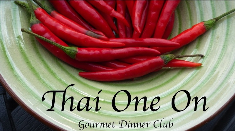 A green bowl filled with fiery Thai chiles, Thai One On - a menu