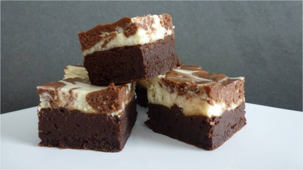 A close up of three squares of delicious gluten free chocolate cheesecake brownies