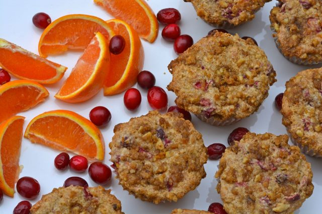 Cranberry Orange Muffins with orange wedges and cranberries.