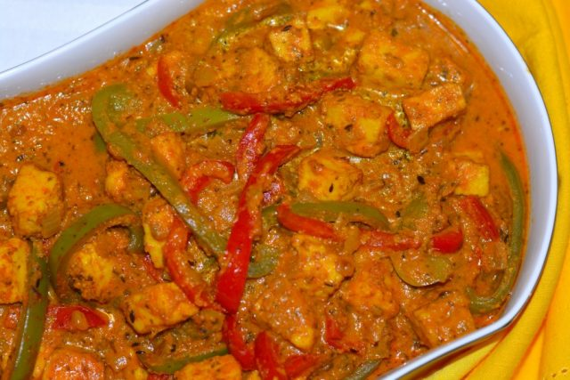 Gluten Free Paneer and Peppers in Fragrant Gravy in a serving dish.