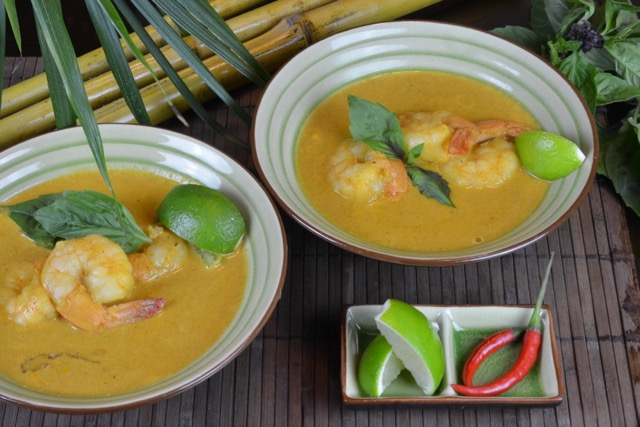 Two bowls of Thai Red Shrimp Curry with lime and chiles