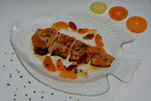 Cooked Arctic Char with Citrus Sauce and chives.