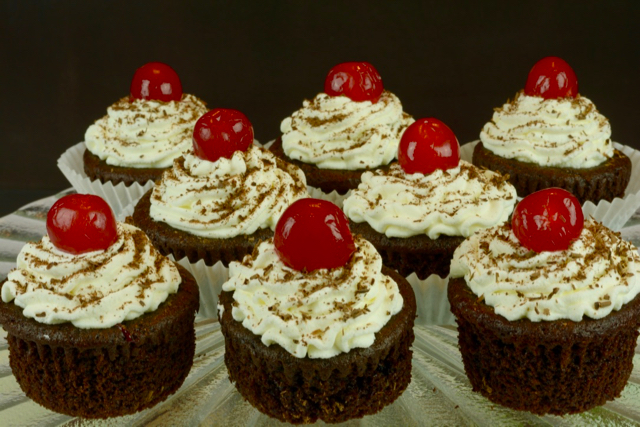A pedestal tray displaying Black Forest Cupcakes