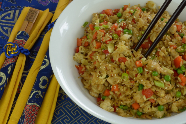 A bowl of Chicken Fried Rice with chopsticks.