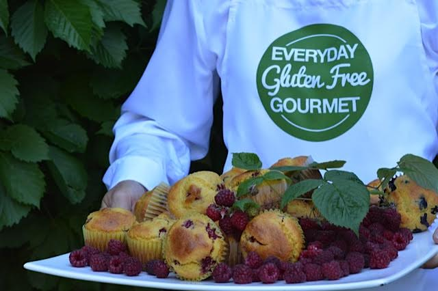 Photo of me holding a tray of my Raspberry Cornmeal Muffins for the Alberta 150 photo contest.
