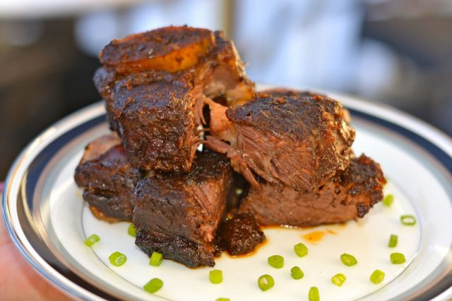 A plate of gluten free Braised Beef Short Ribs in Coffee Ancho Chile Sauce