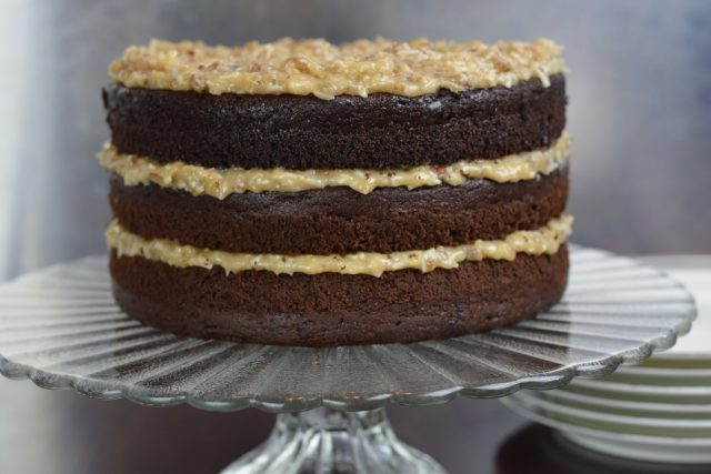 Gluten Free German Chocolate Cake on a pedestal tray.