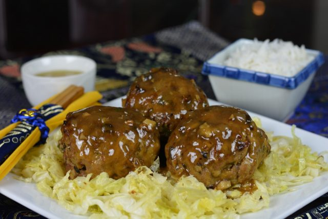 Gluten Free Lion's Head Meatballs served with stir-fry cabbage.