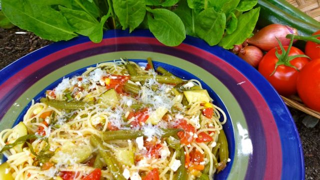 A bowl of pasta with fresh sorrel and feta