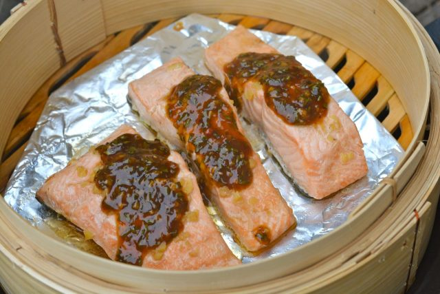 Three pieces of Salmon with Chinese Pesto.