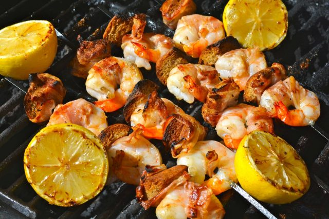 Skewers of Shrimp on the Barbie with pancetta and grilled lemons.