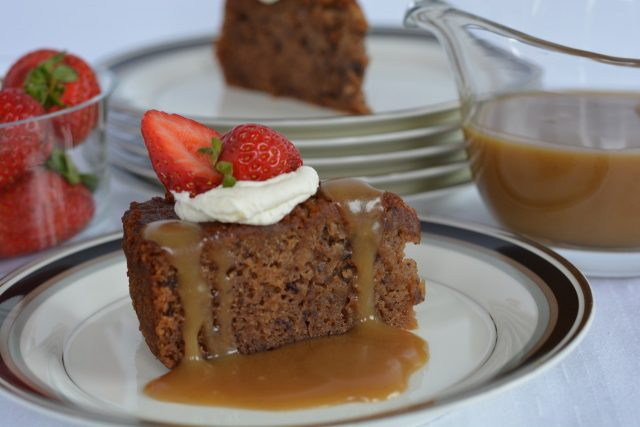 Gluten Free Sticky Date Pudding with caramel sauce and whipped cream.
