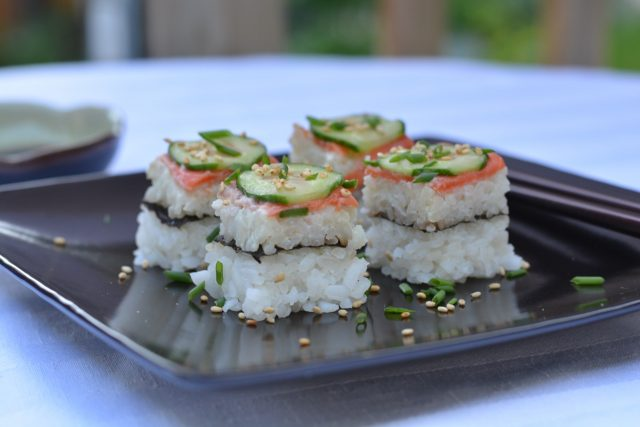 Squares of smoked salmon sushi pizza