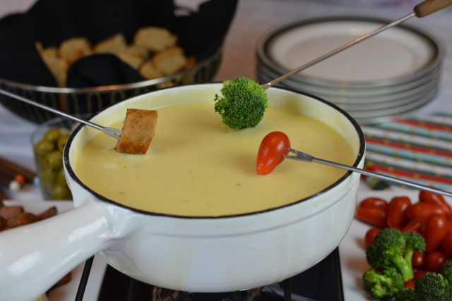 Gluten Free Swiss Cheese Fondue with forks loaded and ready to dip.