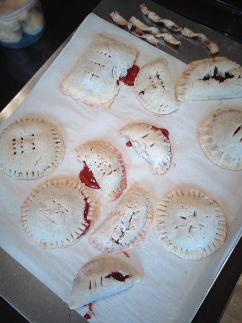 A tray of pale looking Cherry Hand Pies mistakenly made without egg wash.
