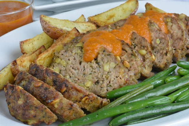 Italian Meat Loaf with Pine Nuts served with homemade tomato sauce.