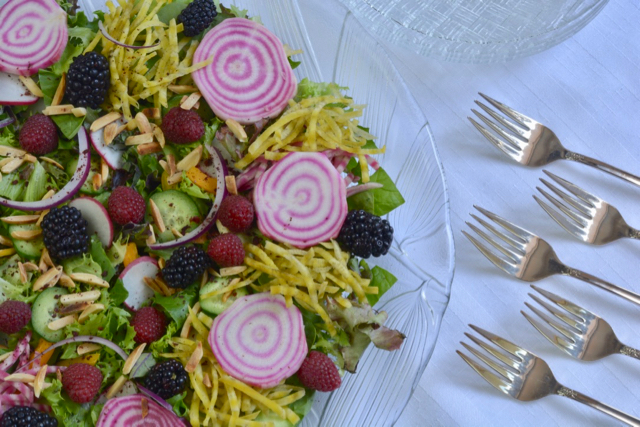 A beautiful Garden Harvest Jewelled Salad with sliced candy cane beets, grated golden beets, raspberries, blackberries and more.