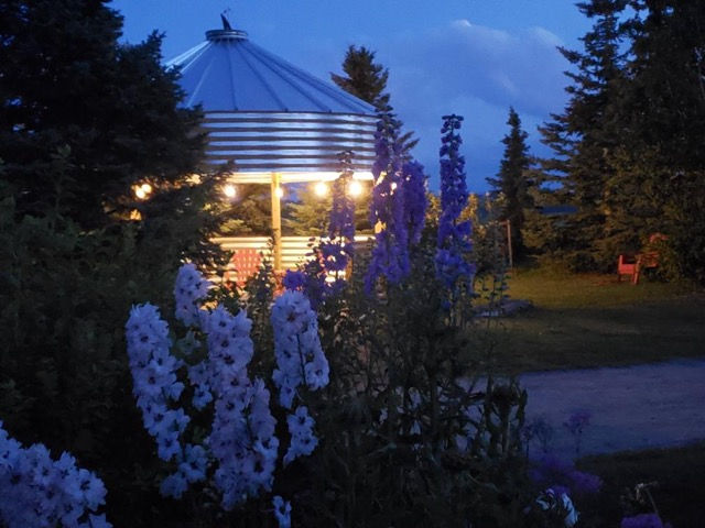An evening view of a modern granary used as an Outdoor Dining Area