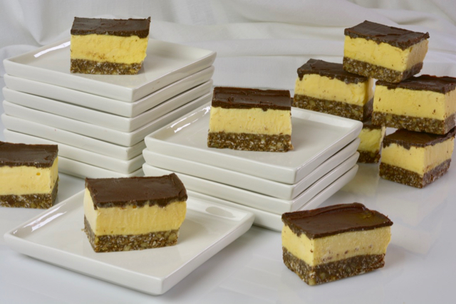 Nanaimo Ice Cream Bars being served on small white plates