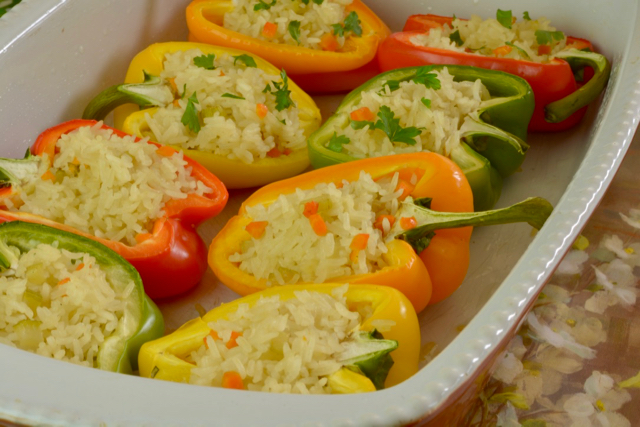 A baking dish of colourful Stuffed Peppers with Rice.
