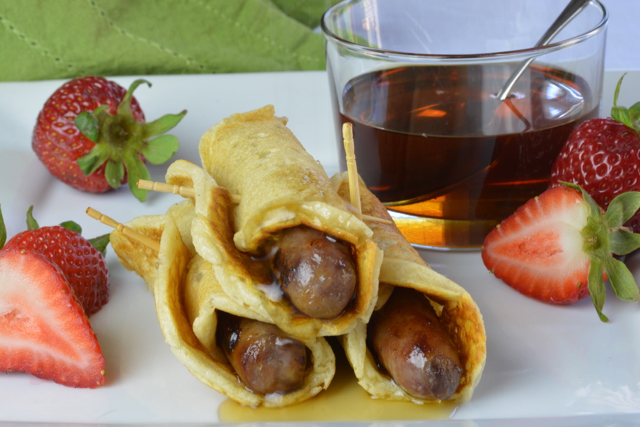 Three Pigs in a Blanket covered in syrup.