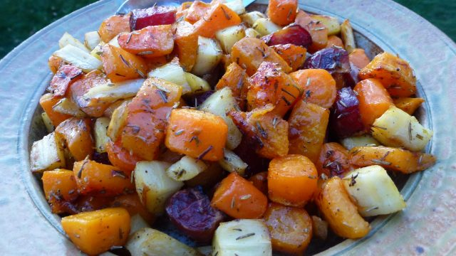 A serving dish of naturally gluten free roasted root vegetables.