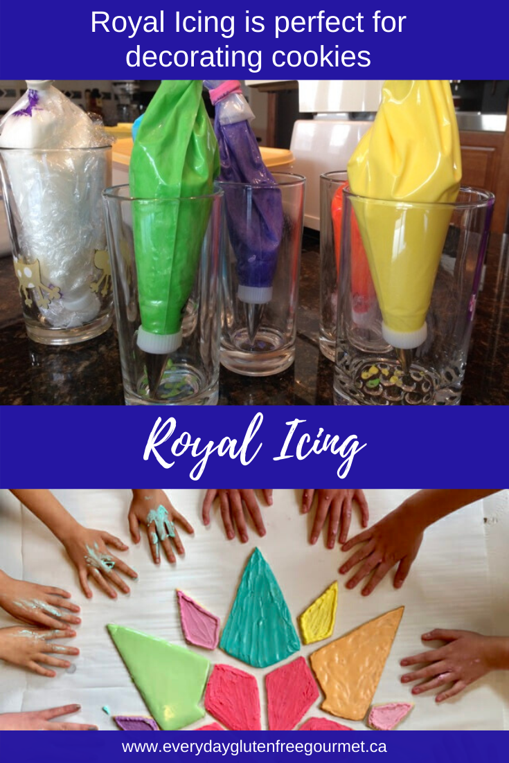 Icing bags filled with royal icing in green, purple, yellow, orange and white. Let the decorating begin!