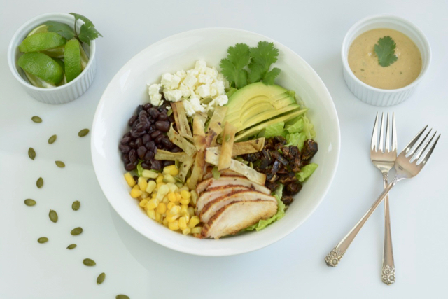 Santa Fe Salad filled with blackened chicken, avocado, corn, beans, feta cheese and dates.