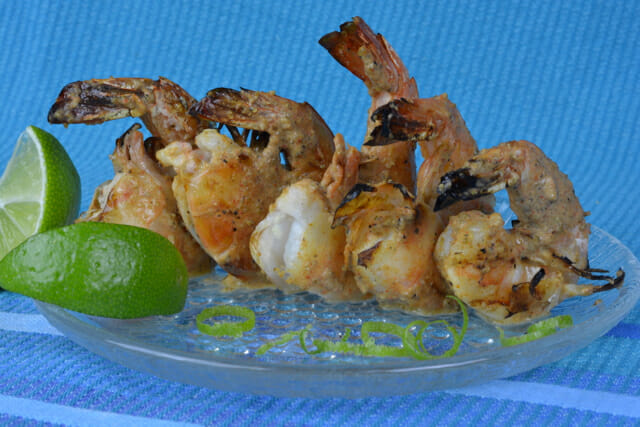Grilled Tandoori Shrimp with fresh lime wedges.