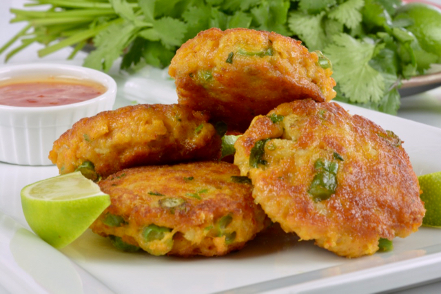 Thai A plate of Thai Fish Cakes made with red curry paste.