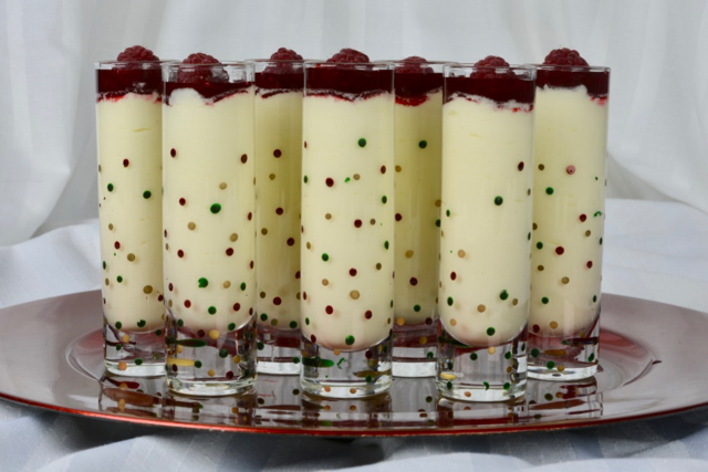 White Chocolate Mousse shots with raspberry sauce and a raspberry
