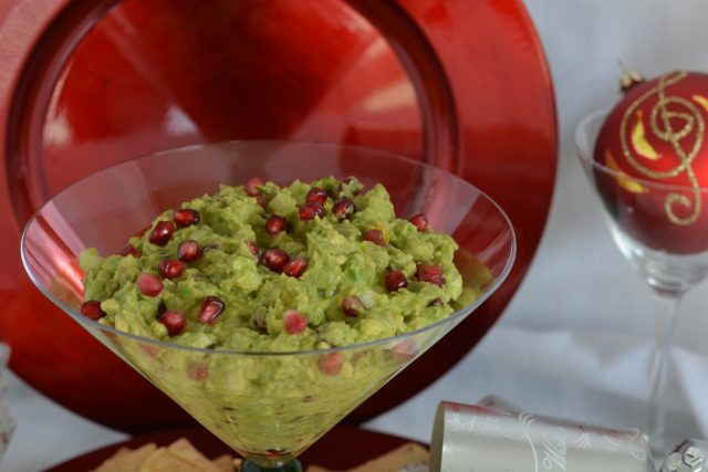 An oversized martini glass filled with Pomegranate Pear Guacamole.