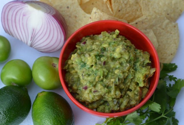 A bowl of homemade, tomatillo guacamole.