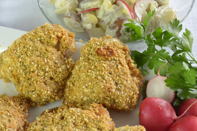 This crunchy Sesame Baked Chicken is delicious hot or cold. Served with potato salad it's perfect for a picnic.