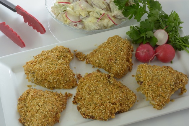 This Sesame Baked Chicken has a delicious crunchy coating made with cornflakes, cornstarch, sesame seeds and parsley. Serve with potato salad and you have a perfect summer picnic!