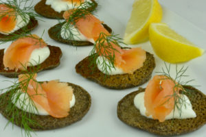 Mini buckwheat Blinis with smoked salmon, sour cream and dill.