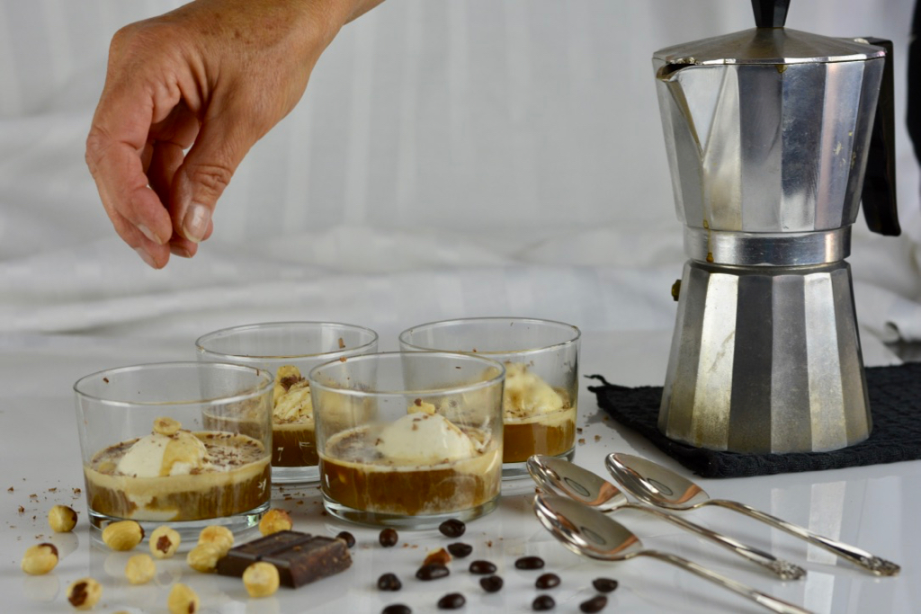 Grated chocolate and hazelnuts are the final toppings for my Italian Affogato.