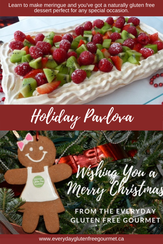 Holiday Pavlova glistening with red and green fruit for a stunning presentation.