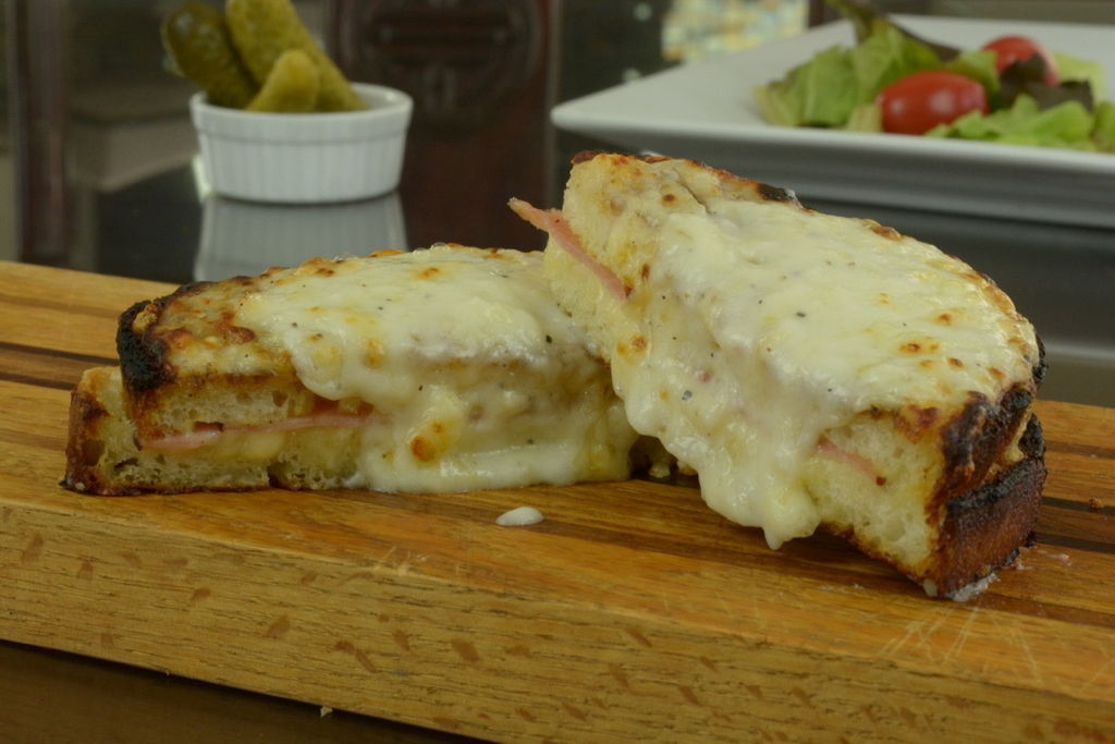Croque Monsieur, the famous French sandwich made with ham and Swiss cheese topped with white sauce.