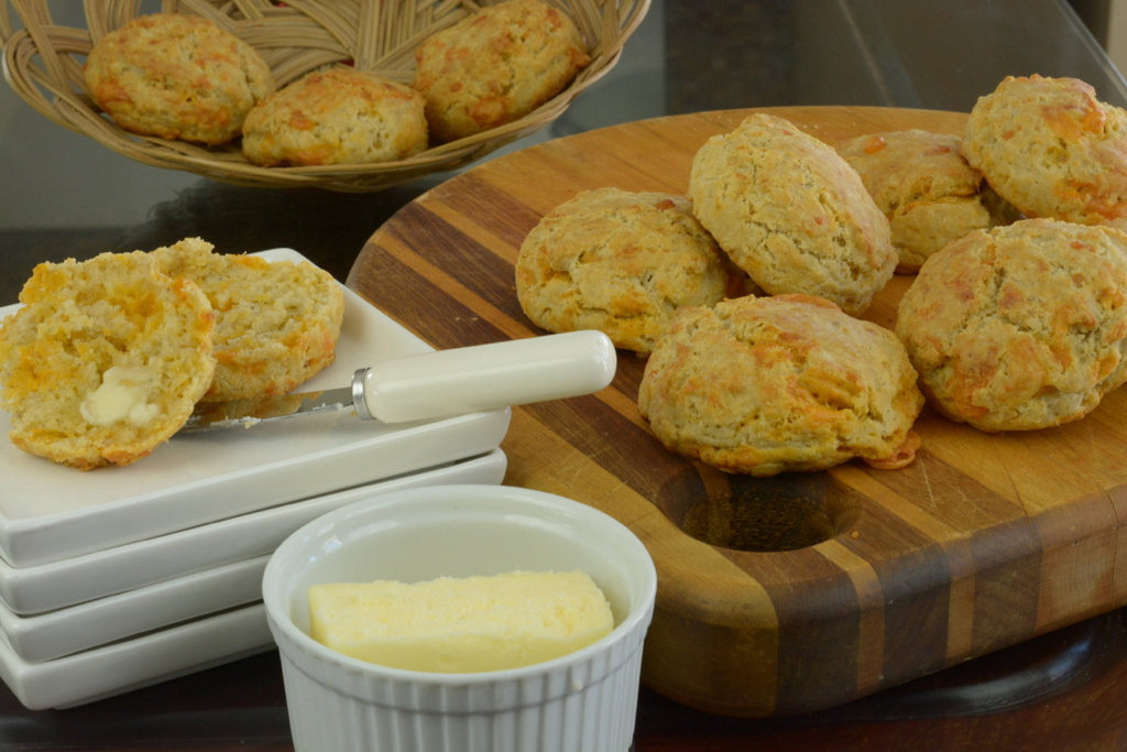 Gluten free Cheese Biscuits on a board served with extra butter.