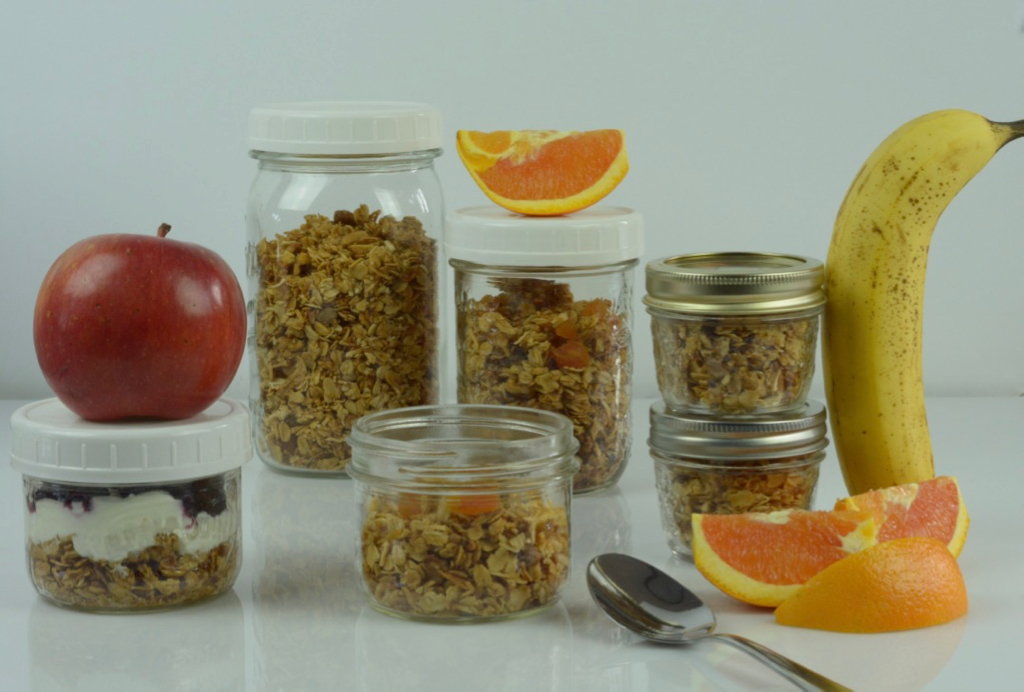 Gluten Free Granola portioned into different sizes of Mason jars and ready to eat.