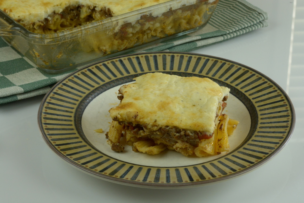 Greek Pastitsio, a layered main course dish with pasta, meat sauce and white sauce.